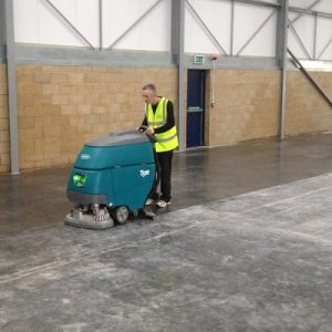Tennant T5 battery walk behind scrubber dryer warehouse cleaning machine