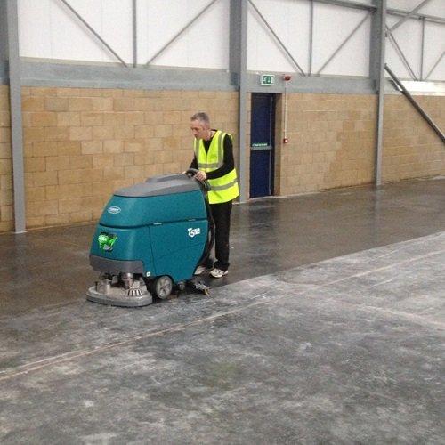 Tennant T5 battery walk behind scrubber dryer warehouse cleaning machine